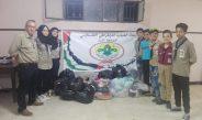 كشافة أشد فوج الغد تبدأ بتوزيع الألبسة و المواد غذائية